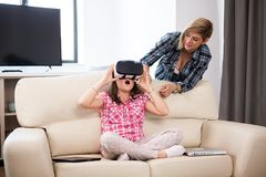 Daughter wearing a VR virtual reality headset on her head Royalty Free Stock Photography