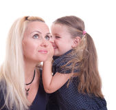Daughter whispering Royalty Free Stock Photo