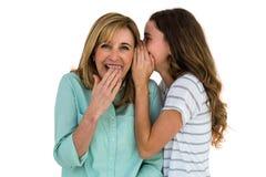 Daughter whispering something Royalty Free Stock Photos