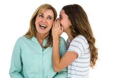 Daughter whispering something Royalty Free Stock Photo