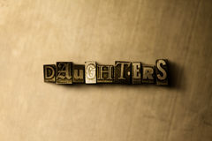 DAUGHTERS - close-up of grungy vintage typeset word on metal backdrop. Royalty free stock illustration.  Can be used for online banner ads and direct mail Stock Photo