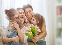 Daughters with dad congratulate mom royalty free stock photos