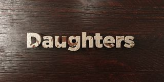 Daughters - grungy wooden headline on Maple  - 3D rendered royalty free stock image. This image can be used for an online website banner ad or a print postcard Stock Images