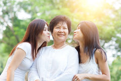 Daughters kissing mother Stock Photography