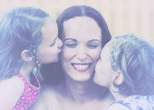 Daughters Kissing their Mother - Retro Royalty Free Stock Images