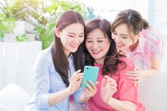 Daughters and mother use smartphone royalty free stock image