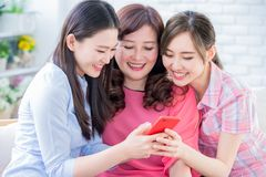 Daughters show mobilephone to mom. Daughters show mom how to use mobilephone royalty free stock images
