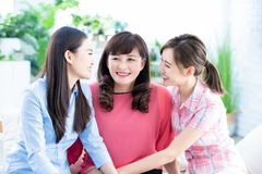 Daughters talk to mother happily royalty free stock photo