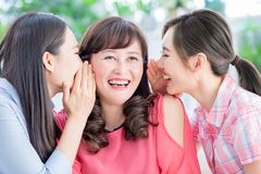 Daughters talk to mother happily royalty free stock photography
