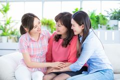 Daughters talk to mother happily stock photography