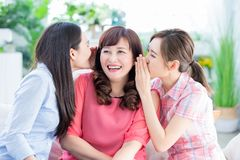 Daughters talk to mother happily stock photos