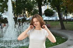 Dauhter in sunny street. Beautiful girl on sunny street in Kiev, Ukraine.nSummer 2017 Stock Image