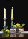Daulton Lambeth bowl and candlesticks - vertical. Antique Dalton Lambeth candlesticks and bowl filled with fresh lemons and leaves royalty free stock photo