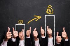 Daumen bis zum wachsenden Einkommen Lizenzfreie Stockfotografie