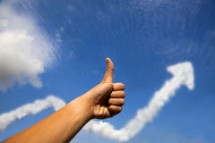 Daumen oben für GeschäftserfolgProfitdiagramm Lizenzfreie Stockfotos