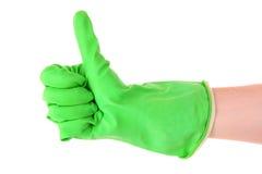 Daumen oben mit einem grünen Handschuh Stockfoto