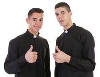 Daumen up Priester Stockbild