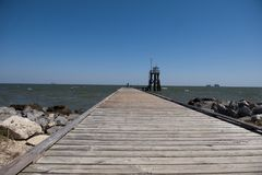 Dauphin island at Mobile Alabama. A view of the boardwalk on the Dauphin island on the Mobile Bay in Alabama, USA Royalty Free Stock Image