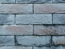 Rock brick on wall for background. Dav rock brick wall background surface old hard grey stock image
