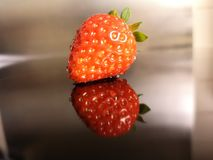 Red strawberry mirror image. Dav strawberry mirror image Royalty Free Stock Images