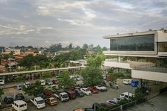 Gaisano parking space seen from its third floor lobby. Davao, Philippines - January 19, 2018: Part of Gaisano Mall seen from third floor lobby. Parked vehicles Royalty Free Stock Images