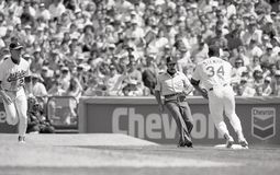 Dave Stewart covers first base. Oakland pitcher Dave Stewart covers first base on a ball hit to Mark McGwire. Image taken from b&w negative stock photos