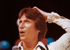 David Brenner. Performs in-concert at the Drury Lane East Theatre in Chicago, Illinois, in 1980.   Brenner was a pioneer of observational comedy, and was a Royalty Free Stock Image