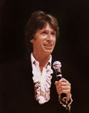 David Brenner. David  Brenner performs in-concert at the Drury Lane East Theatre in Chicago, Illinois, in 1980.   Brenner was a pioneer of observational comedy Royalty Free Stock Images