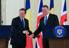 David Cameron and Klaus Johannis. British Prime Minister David Cameron ( L ) visited Romanian President Klaus Johannis at presidential Cotroceni Palace, in Stock Photos