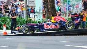 David Coulthard que conduce Red Bull que compite con el coche F1 Imágenes de archivo libres de regalías