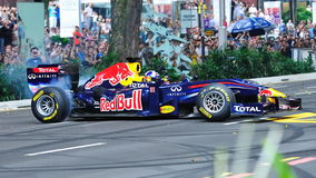 David doing donuts in Red Bull Racing F1 car Royalty Free Stock Photography