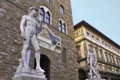 David in front of Palazzo Vecchio. The Palazzo Vecchio and a statue of David in front of it in Firenze, Italy Royalty Free Stock Photography