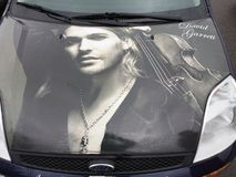 David Garrett on a bonnet. A true fan of the David Garrett. Here pictured on a bonnet of a car parked in Gadebusch, Germany Stock Photo