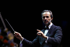 David Gimenez. Spanish conductor David Gimenez pictured during Jose Carreras's last world tour 'A Life In Music', at Romexpo indoor arena, in Bucharest, Romania Royalty Free Stock Photo