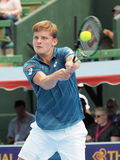 David Goffin of Belgium with a high backhand Royalty Free Stock Image