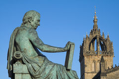 David Hume and St Giles Cathedral, Edinburgh. Monument to the Scottish Enlightenment philosopher David Hume on Edinburgh's Royal Mile with the crown spire of St Royalty Free Stock Photo