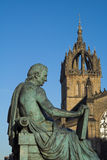 David Hume and St Giles Cathedral, Edinburgh. Monument to the Scottish Enlightenment philosopher David Hume on Edinburgh's Royal Mile with the crown spire of St Stock Photos