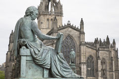 David Hume Statue by Stoddart with St Giles Cathedral, Royal Mil Royalty Free Stock Image