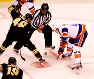 David Krejci and P.A. Parenteau Face-off. Stock Photos