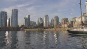 David Lam park Yaletown from the water on sunny day. VANCOUVER,CANADA - CIRCA December 2014 :David Lam park Yaletown from the water on sunny day stock footage