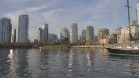 David Lam park Yaletown from the water on sunny day stock footage