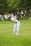 David Lynn. Clubbing the ball up the 1st fairway, toward the green Stock Image