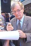 David McCallum. David signs autographs at Walk of Fame ceremony for Mark Harmon Royalty Free Stock Photography