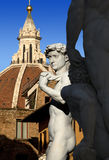 David by Michelangelo and Dome of The Cathedral - Florence Italy Royalty Free Stock Photo