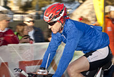 David Noyes Racing in the Arizona Ironman Triathlo Stock Images