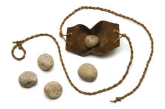 David's Sling. Sling and five smooth stones used by David to kill Goliath on a white background stock photo