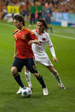 David Silva vs. Tuncay. MADRID - MAR. 28, 2009: Spain's David Silva holds the ball against a challenge from Turkish player Tuncay Sanli during the second half of Stock Photos