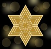 David star in gold design. Star of David on black bokeh background with soft lights.  Royalty Free Stock Photography