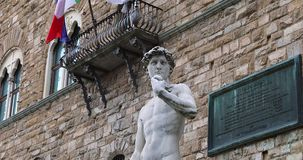 David Statue In Front Of Palazzo Vecchio In Florence. Florence, Italy - August 31, 2019: Marble David Statue By Michelangelo With Italian Flag In Front Of stock video footage