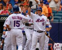 David Wright congratulates Carlos Beltran. New York Mets 3B David Wright (5) high-fives teammate Carlos Beltran (15) after Beltran's home run Stock Photo